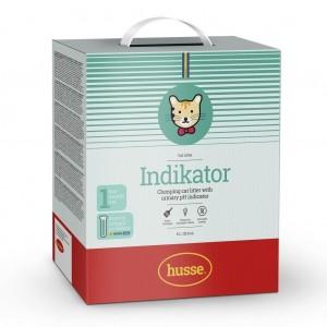 caja de arena aglomerante de color blanco, verde y rojo con la bandera sueca y el logo del gato husse, Indikator